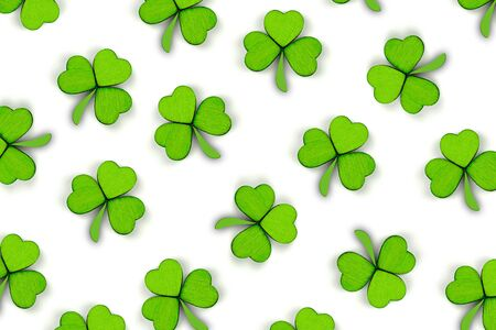 Pattern of green clovers or shamrocks isolated on white background. St. Patrick's Day Holiday concept. Spring background.