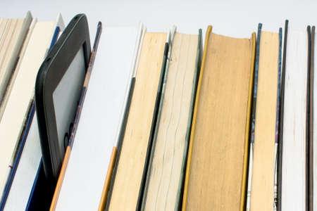 the shelf: E-book on a shelf with books