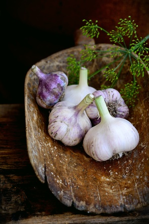Violet  spring garlic in wooden wooden dipper in rustic style photo