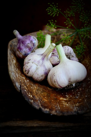 Violet  spring garlic in wooden wooden dipper in rustic style Stock Photo