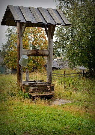 draw well: old well in the Russian northern village