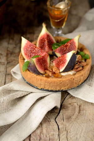 fresh tart or pie with figs and cream, served with a glass of honey. See series photo