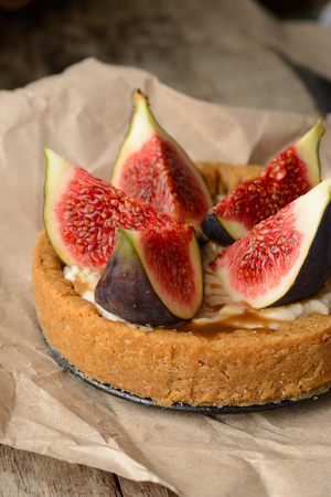 fresh tart or pie with figs and cream, served with a glass of honey. See series Stock fotó