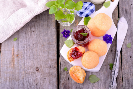 afternoon break: scone with strawberry jam, tea party , afternoon tea , buttermilk biscuits. Selective focus Stock Photo