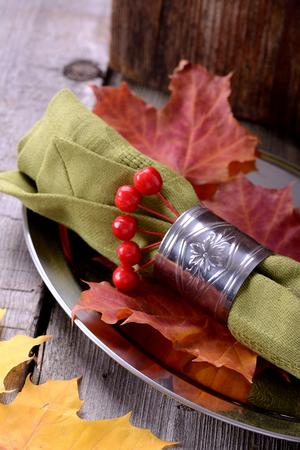 napkin ring: napkin ring on a platter autumn still life Stock Photo