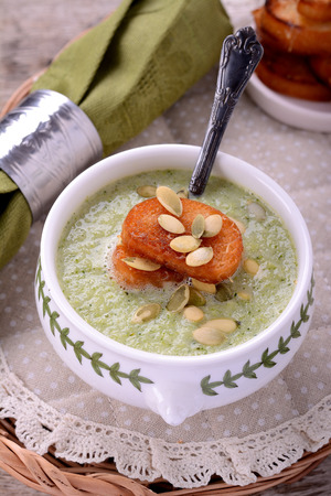 Cream soup with broccoli, beans, Parmesan cheese and croutons photo