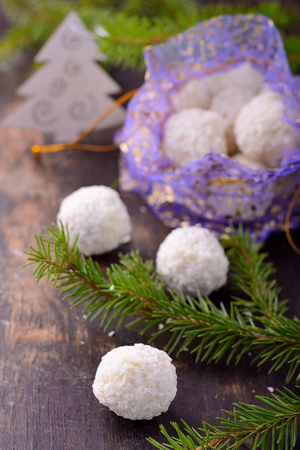 coatings: Homemade Christmas chocolate candies with coatings such as coconut Stock Photo