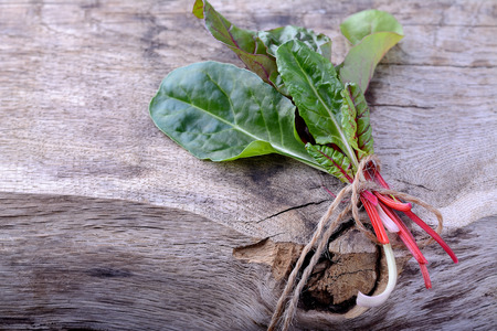 Bunch of swiss chard on a wooden background. selective focus