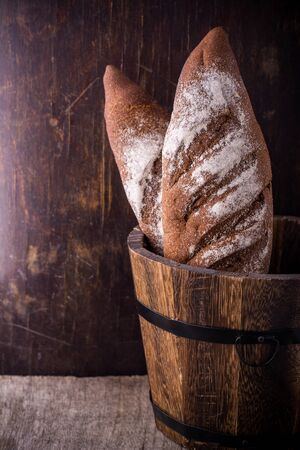 artisan bakery: A loaf of fresh rustic wholemeal rye bread
