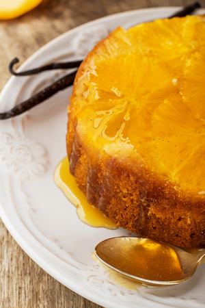 impregnated: Homemade orange cake upside down. With natural vanilla and honey. selective Focus