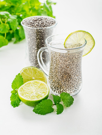 Chia seeds drink with water in transparent glass with lime and lemon balm. selective Focus 版權商用圖片