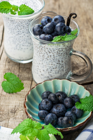 Chia seed pudding made with blueberries vanilla and mint on a wooden background. Selective focus. The concept of good nutrition