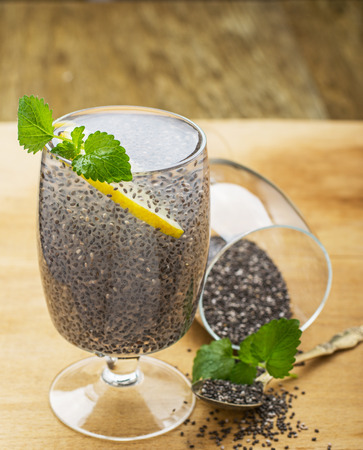 Chia seeds drink with water in transparent glass with lime and lemon balm. selective Focus Standard-Bild