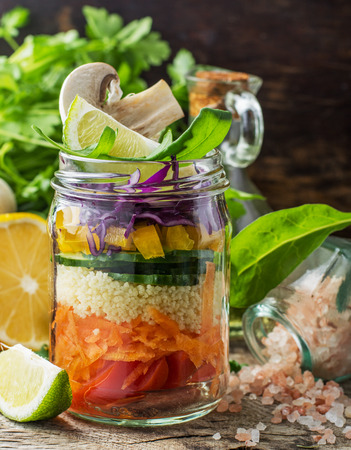 Rainbow salad in a jar of layers of different vegetables, mushrooms and herbs on dark wooden background surrounded by fresh vegetables and mushrooms. Concept of healthy food. selective Focus 版權商用圖片 - 38445816
