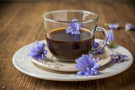 chicory coffee: Chicory flowers and tea from chicory. Selective focus