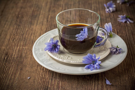 milkman: Chicory flowers and tea from chicory. Selective focus