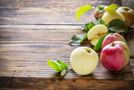 text space: Apples on wooden background in the form of frames of different varieties. selective Focus Stock Photo