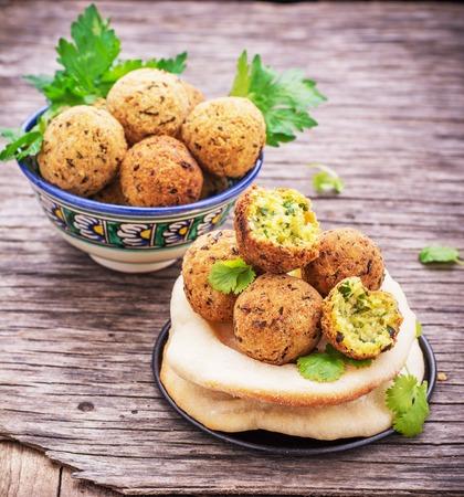 Fresh homemade falafel chickpea on wooden background freshly baked cakes pita. selective Focus 版權商用圖片 - 46807181