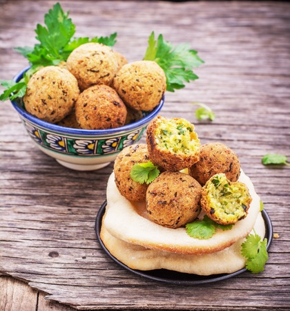 Fresh homemade falafel chickpea on wooden background freshly baked cakes pita. selective Focus