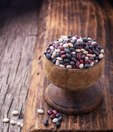 lima bean: Colored assorted beans in old wooden bowl on dark wooden background. selective Focus Stock Photo