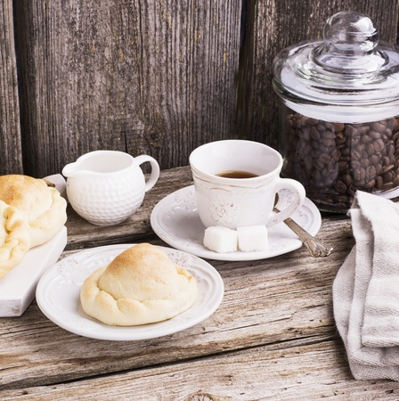 storing: Morning still-life in the kitchen during breakfast with a jar of coffee beans, sugar cubes, fresh homemade cakes, cup and creamer. Ideas of storage in the kitchen, healthy home cooking. selective Focus Stock Photo