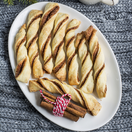 comfort food: Cozy flavorful baked crispy sticks with cinnamon for tea, snacks, picnic, as a gift for a holiday. Top view. comfort food concept Stock Photo