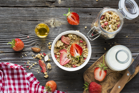 freeze dried: Healthy breakfast. Strawberry granola with almond petals and fresh berries. Served  milk, honey  mint. Top view Stock Photo