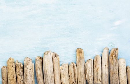 Summer background, driftwood marine items, sea objects on turquoise blue wood with copy space. Stock Photo