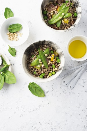 Healthy food. green buckwheat. High protein vegetable food: buckwheat, young green peas, capsicum yellow, spinach, pine nuts bowl of health. The concept of eating. Mediterranean cuisine. Trend Stok Fotoğraf