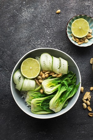 Rice boc choy lime cucumber vegetarian bowl for a healthy diet. Top View