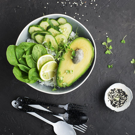 Vegetarian vegetable summer avocado micro-greenery bowl. Top View
