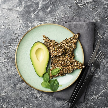Ketogenic low carbs diet concept. Healthy eating and dieting. Ketogenic kitchen recipes: bread or crackers from seeds without flour, sugar. Quinoa, sesame, pumpkin seeds, sunflower seeds.