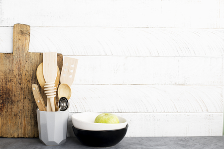 Kitchen shelf with appliances and cutlery against a white wooden wall. Horizontal. Copy space. No plastic concept Imagens