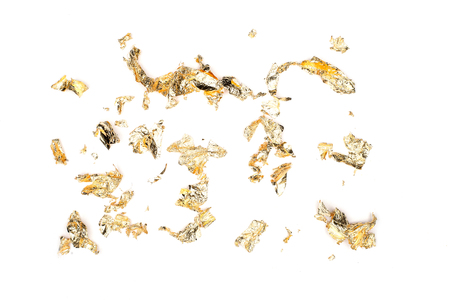 Flakes sheets of gold foil isolate on white