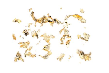 Flockenblätter aus Goldfolie isolieren auf weiß