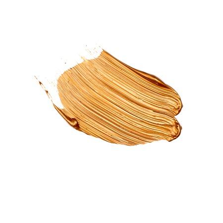 Brush strokes golden paint texture cosmetics isolated on white Stok Fotoğraf