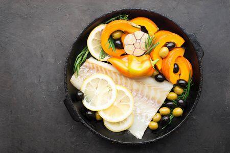 Homemade simple healthy. Farmer market vegetables white cod fish on a baking tray 版權商用圖片