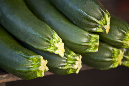 Fresh courgettes on a wooden table Stock Photo