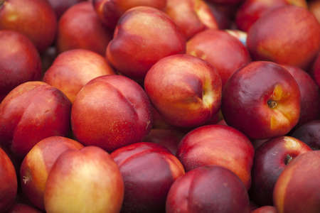A group of colorful nectarine fruits on a market Banque d'images