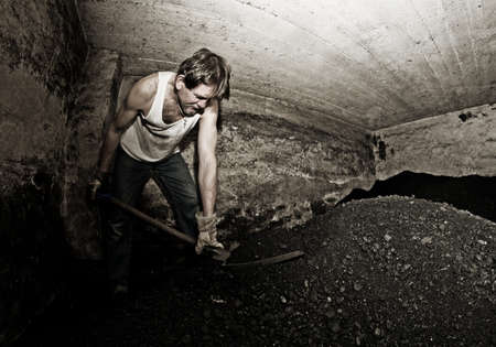 the miner: Adult man portrait, working in a mine.