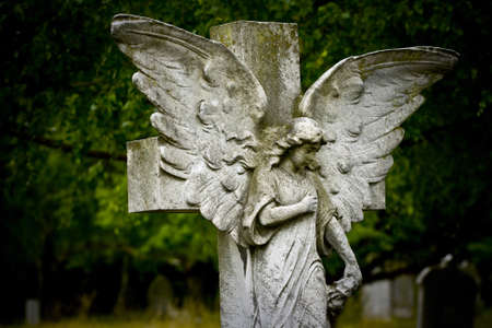 Old cemetery angel sculpture made of stone