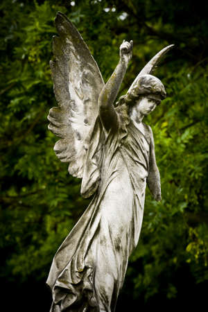 Old cemetery angel sculpture made of stone photo
