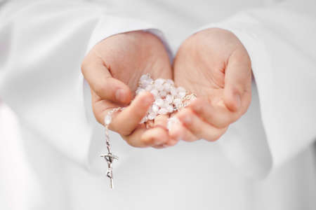 First Holy Communion concept - close up on rosary on child's hands Zdjęcie Seryjne - 20002845