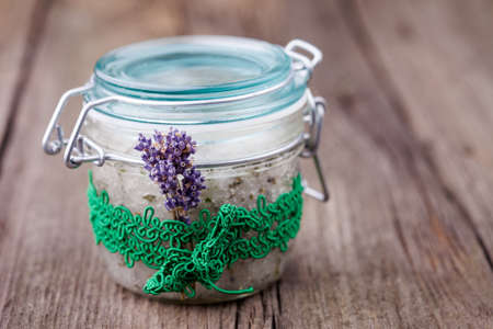 Handmade DIY natural sugar body scrub with lavender and coconut oil photo