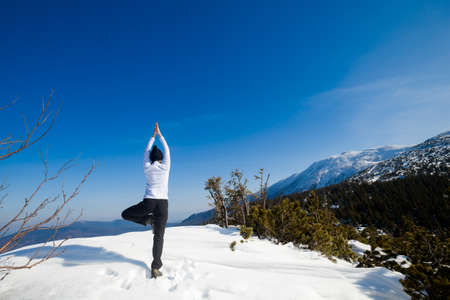 Winter yoga session in beautiful place - Beskid mountains, Poland. Babiagora National Park Stock Photo