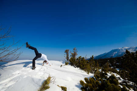 Winter yoga session in beautiful place - Beskid mountains, Poland. Babiagora National Park photo