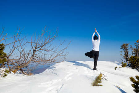 Winter yoga session in beautiful place - Beskid mountains, Poland. Babiagora National Park Stock fotó
