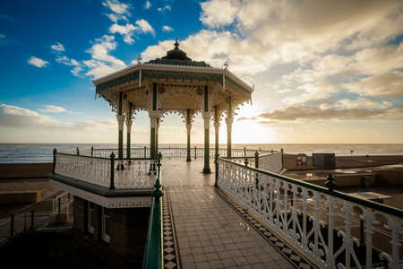 Sunset view on beautiful Brighton bandstand during sunny day, with blue sky