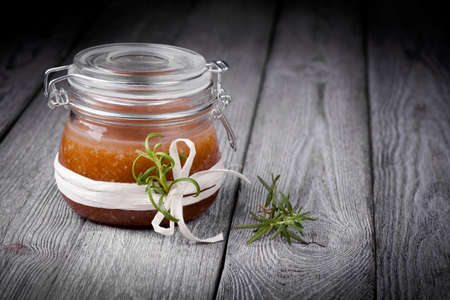 Handmade DIY natural sugar and salt body scrub with ginger, rosemary, almond and coconut oil