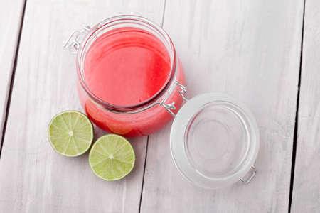 skin scrub: Handmade DIY natural sugar and salt body scrub with fresh lime, almond and coconut oil